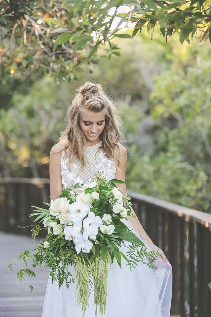Romantic gowns from Erin Clare, bohemian bouquets and feminine hair and beauty reveal a softer side to the beach wedding style.