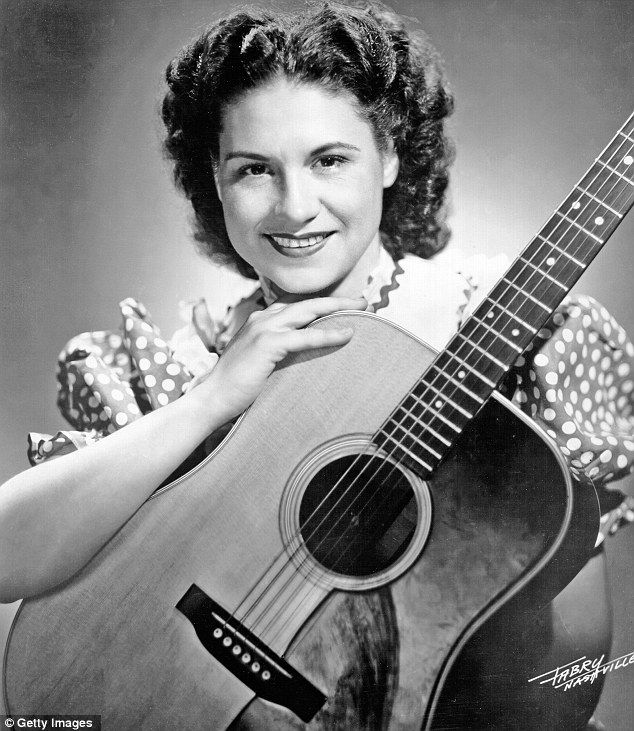RIP Kitty Wells A pioneer: The singer's track It Wasn't God Who Made Honky Tonk Angels in 1952 was the first No. 1 hit by a woman soloist on the country music charts