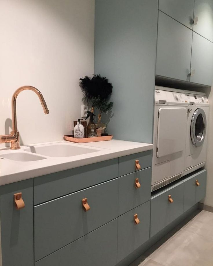 An ultra-chic laundry room with leather drawer pulls.