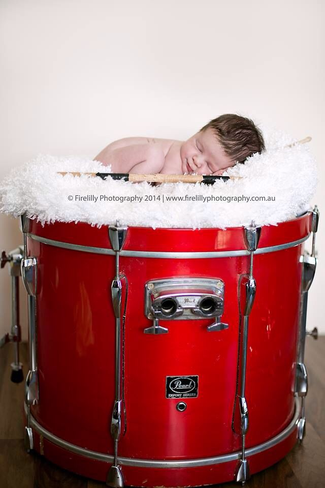 Newborn posing on a drum