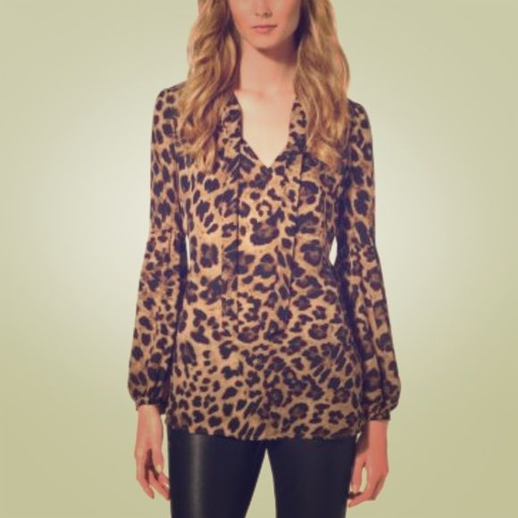 Michael Kors animal print blouse ❤️ tie neck- xxs Gorgeous animal print blouse with neck tie for a chic look! Size is Xxs on tag; this can fit Xxs to small or 00 to a small size 2. Easy to wear and care MICHAEL Michael Kors Tops Blouses