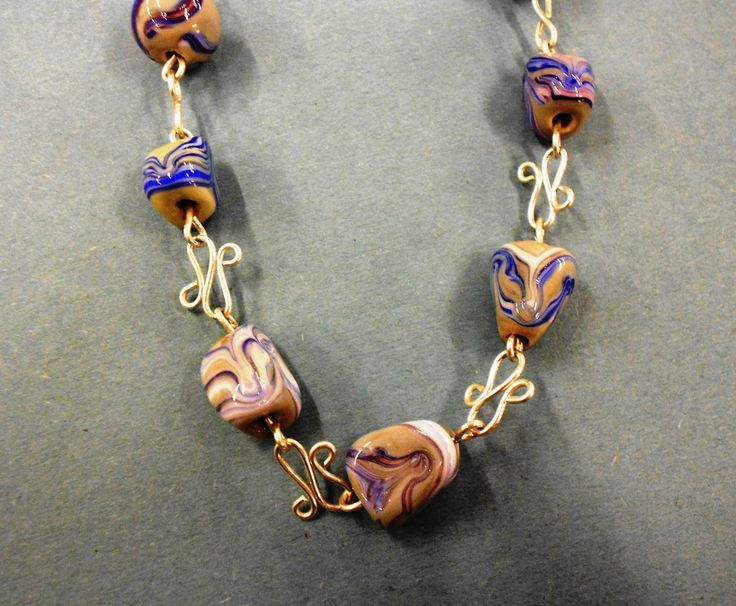 More glass beads and different cold connected chain by Hilary Goodwin