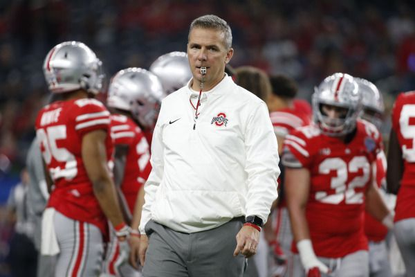 Dec 29, 2017; Arlington, TX, USA; Ohio State Buckeyes head coach Urban Meyer on the field before the game against the USC Trojans in the 2017 Cotton Bowl at AT&T Stadium. Mandatory Credit: Tim Heitman-USA TODAY Sports