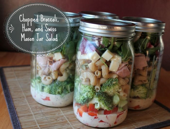 Chopped Broccoli Ham and Swiss make ahead Mason Jar Salad with whole grain pasta, yogurt cole slaw dressing and pumpkin seeds. Great food prep idea.
