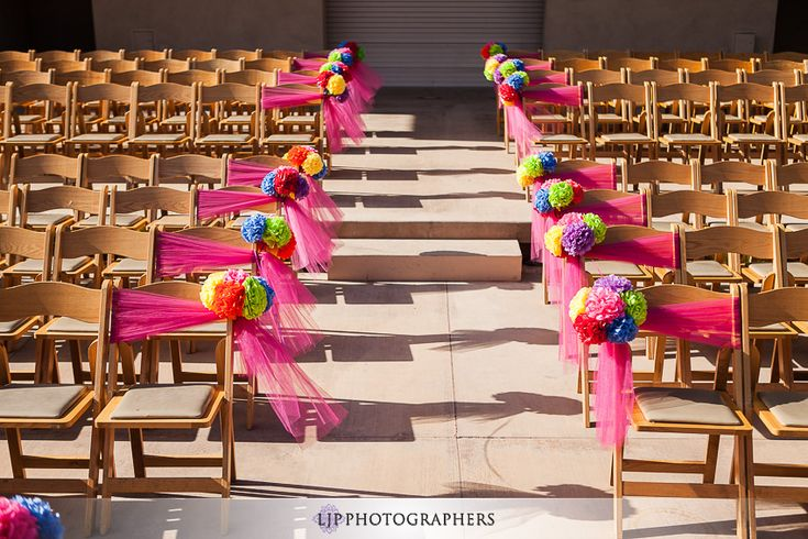 I love the idea of using the paper flowers at my wedding and this simple aisle. (museum-of-latin-american-art-wedding)