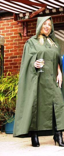 A Happy Lady In Her Hooded Green Rubberlined Cotton Cape