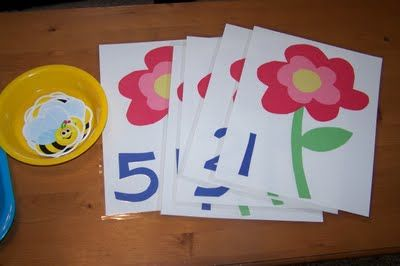 Place correct number of bumble bees on each flower sheet (counting, early math)  **I pieced the flowers together with construction paper and laminated them.