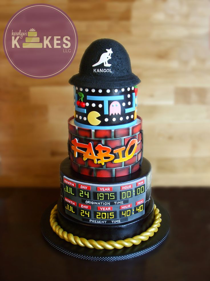 80's KAKE!  All 3 cakes are covered in marshmallow fondant.  Back to the Future board, Run DMCrope chain, bricks, breakdancers, graffiti, pacman are all marshmallow fondant.  Kangol hat is rice cereal.
