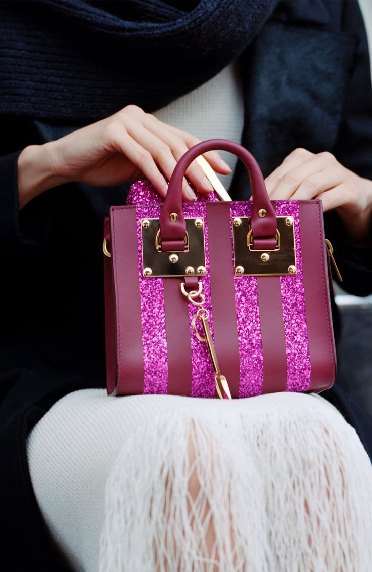The Box Albion in Fuchsia Glitter Stripe is perfect for the festive season and beyond. Carry for day, or night, all year round.