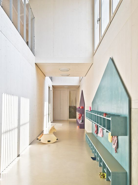 Alternating roofs break down scale of Von M's slatted timber kindergarten: