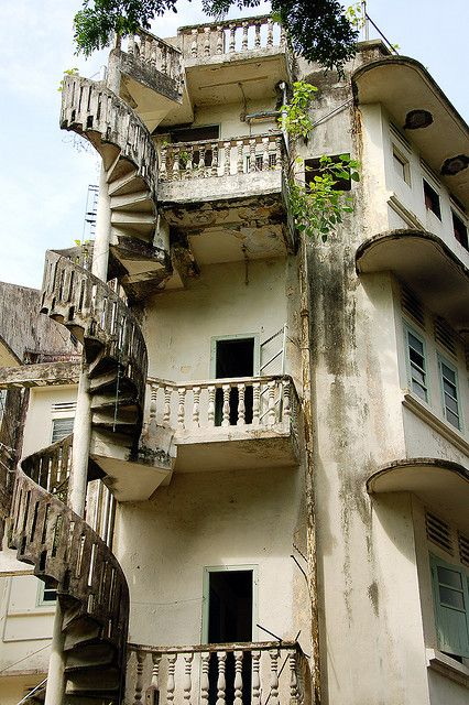 Abandoned spiral balcony -- looks like those steps would crumble beneath the lightest footstep.