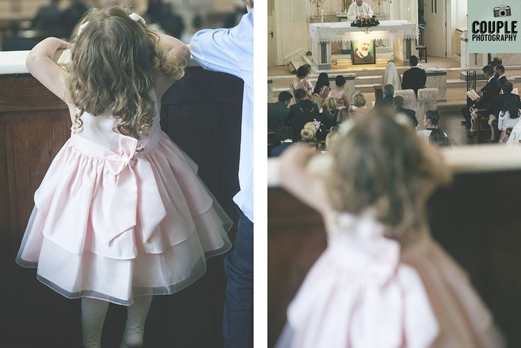 The young daughter of the bride & groom stands on her tippie toes to try and watch mammy & daddy get married. Weddings at Durrow Castle photographed by Couple Photography.