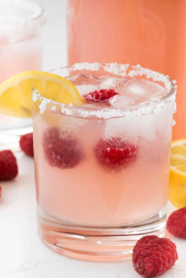 Raspberry Lemonade Margarita - this EASY cocktail recipe is the perfect margarita! Raspberry Lemonade, tequila, and triple sec- that's all it takes!