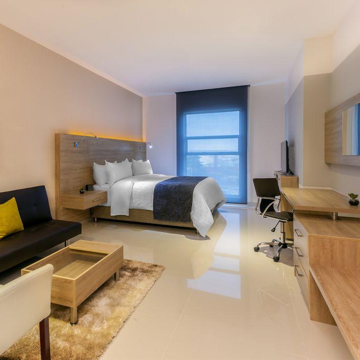Habitación Cama King Hotel GHL Collection Barranquilla.