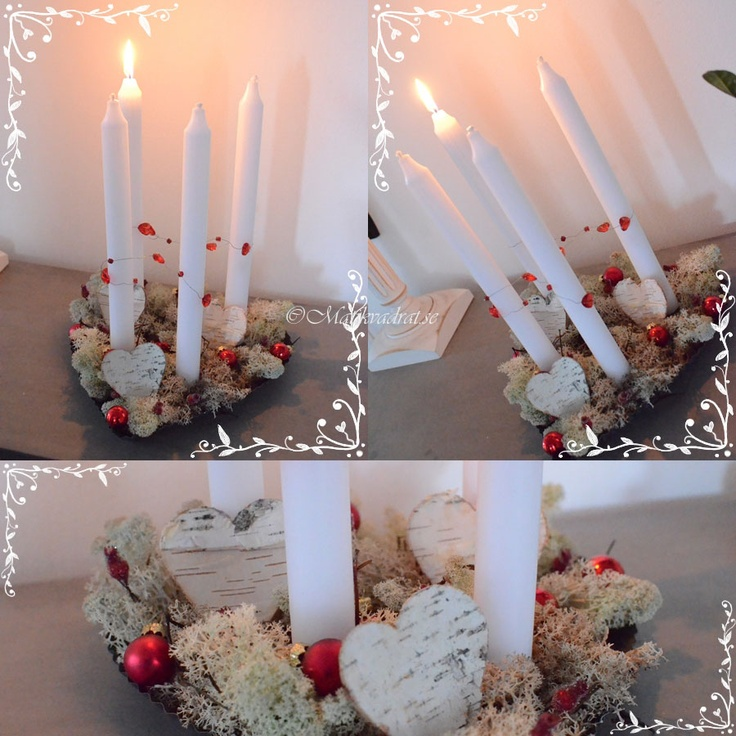 Advent candle holder.  A heart shaped zink candle holder, with white tapered candles. Decorated with white/grey moss, birch-bark hearts and mini christmas baubles.