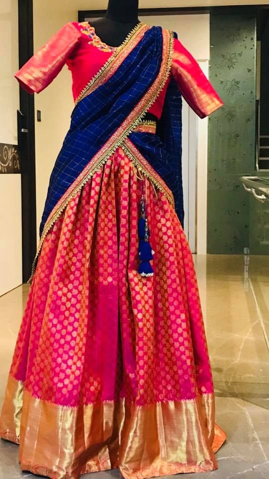 Beautiful pink color kanjiaram lehenga and blouse with royal blue color dupatta. Blouse with floret lata design hand embroidery work on neck line    10 March 2018