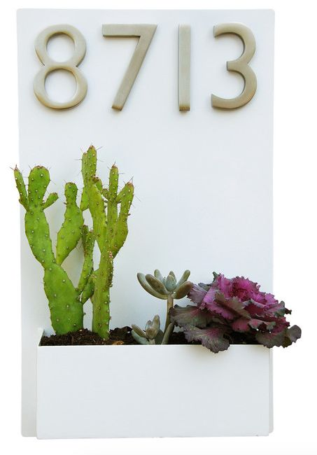 http://www.houzz.com/photos/12296725/Metal-Wall-Planter-and-Address-Plaque-White-With-Numbers-southwestern-house-numbers