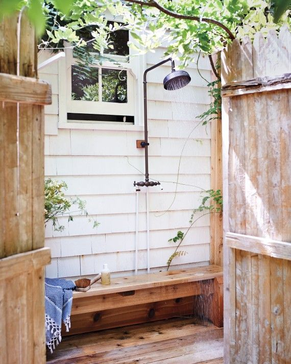 The outdoor shower is a must for after a trip to the beach, and the wisteria vines make it extra inviting.