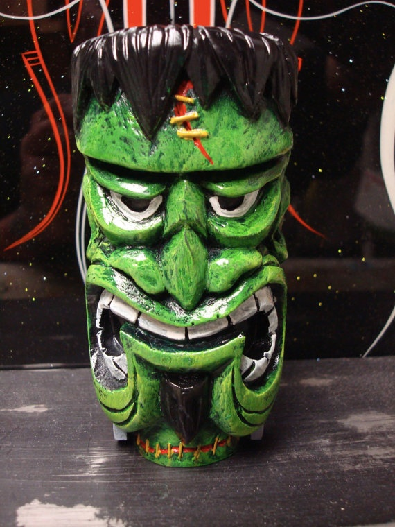 i like the shape of the mouth...   green faced monster frankenstein meets wood carved tiki mask / statue.