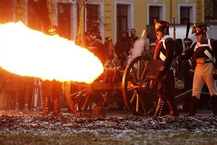 Historical re-enactors dressed as Russian imperial soldiers from the French Invasion of Russia of 1812 fire a cannon during celebrations to mark the Russian Orthodox Christmas in St. Petersburg, Russia, Saturday, Jan. 7, 2012    http://hosted.ap.org/dynamic/files/photos/4/46a4aa83-7919-45b1-adb0-db1c371d2ee7.html?SITE=VALYD&SECTION=HOME&TEMPLATE=DEFAULT