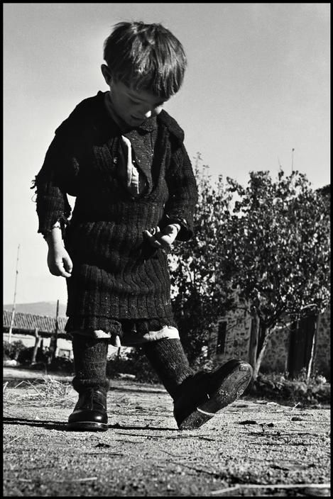 David Seymour GREECE. Oxia. 1947. Elefteria, the only child not evacuated from her remote village during the ravages of the civil war there, receives her first pair of shoes