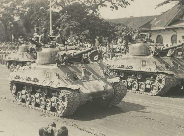 Colonel J.A.J. de Bruyn walking past a Sherman tank in Soerabaja, Dutch East Indies, late 40's