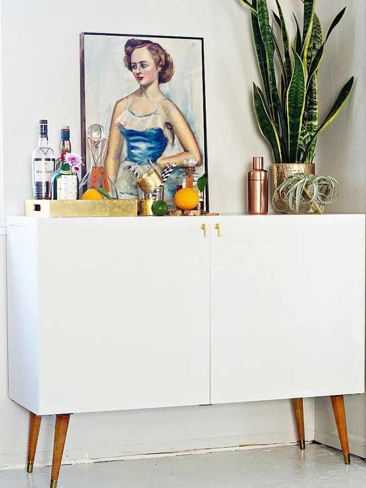 Blogger Brittany Makes hacked her BESTA to create this cute bar cart: vintage legs and brass-tone pulls make this piece barely recognizable as IKEA. A quick and easy DIY improvement changed the entire feel of this BESTA bringing it some modern mid-century vibes.