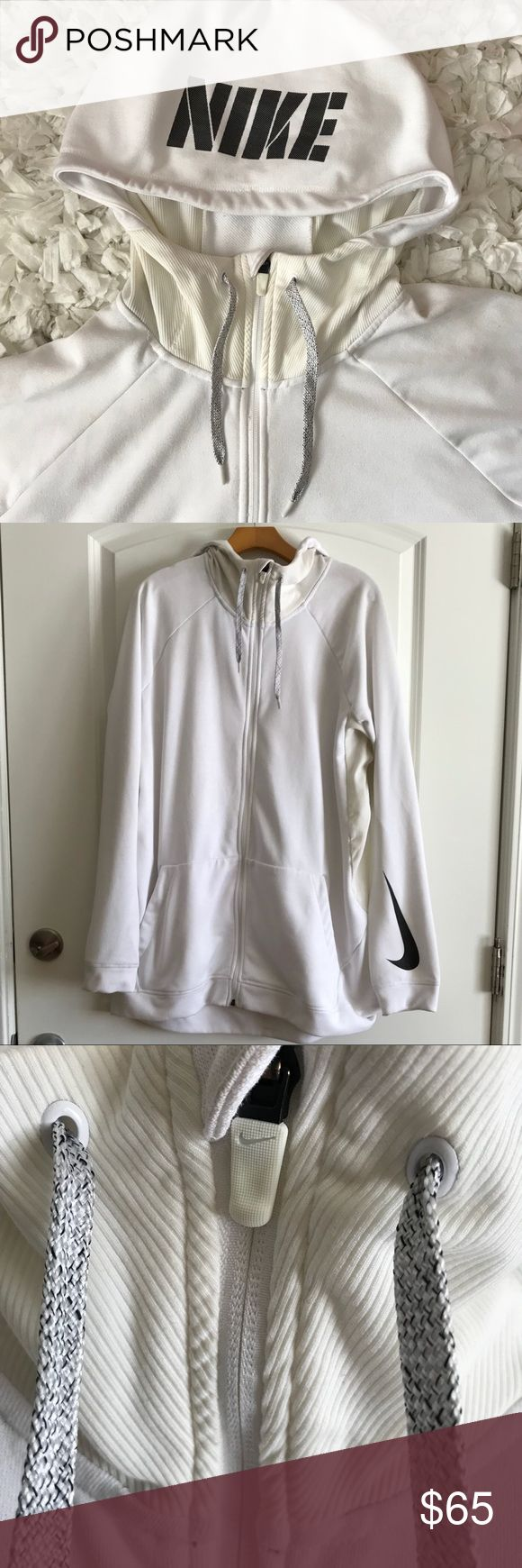 Nike Basketball White Zip Up Hoodie With Pockets Nike Zip Up hoodie with pockets. High neck detail. Nike swoosh on sleeve. Nike logo on hood. In excellent condition. Nike Jackets & Coats