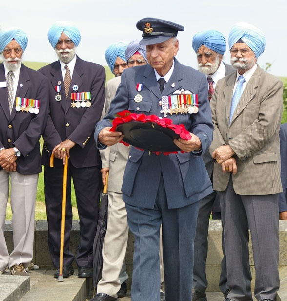 World War II Battle of Britian RAF fighter pilot Squadron Leader Mohinder Singh Pujji, DFC, PCS lays a wreath in the 2009 Chattri Memorial ceremony in England accompanied by other Sikh veterans. At this spot Sikh and Hindu soldiers who died at the Brighton hospitals during World War I were cremated. After the war the town of Brighton built the Chattri Memorial here. To learn more see the SikhMuseum.com Exhibit - Doctor Brighton's Pavilion