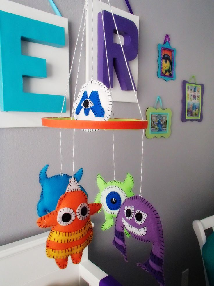 My Monsters Inc Nursery - Mobile made with felt and cotton balls cost less than $10. Modeled after an Etsy version that cost $100.