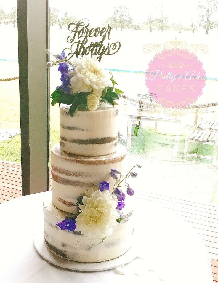 3 tiered Semi naked Wedding cake with fresh flowers