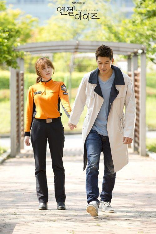 SBS Angel Eyes - Yoon Soo Wan (Goo Hye Sun) looks bewildered as Park Dong Joo (Lee Sang Yoon) drags her to tell her the good news.