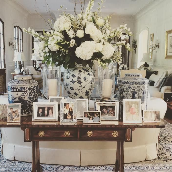 side table   styling   vignette   glam   picture display   white flower  boquet   Family Room DesignFamily. Best 25  Family room decorating ideas on Pinterest