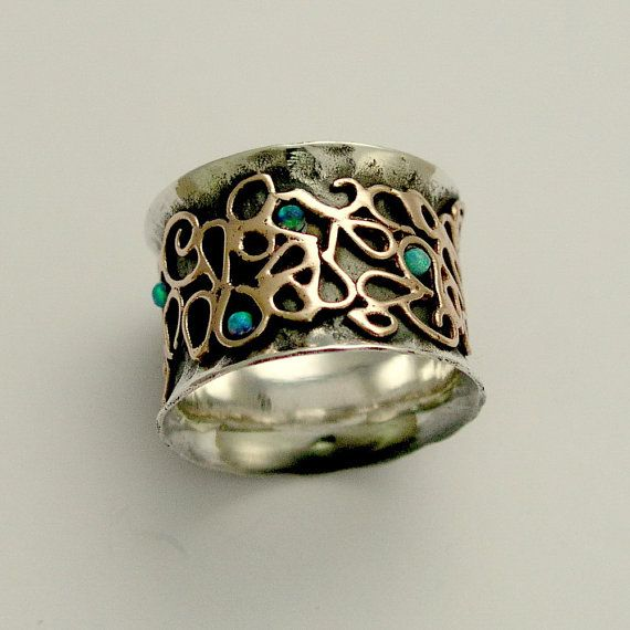 Wide sterling silver band with yellow gold design door artisanimpact