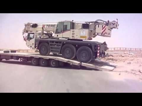 Loading a Crane Onto a Flatbed Truck Goes Wrong