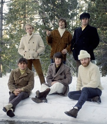 Lake Arrowhead, Southern California; early 1966, in the snow; Top Row:  Al Jardine, Dennis Wilson pointing, and Carl Wilson in navy blue; Bottom Row:  Bruce Johnston, Brian Wilson, and Mike Love in ski cap
