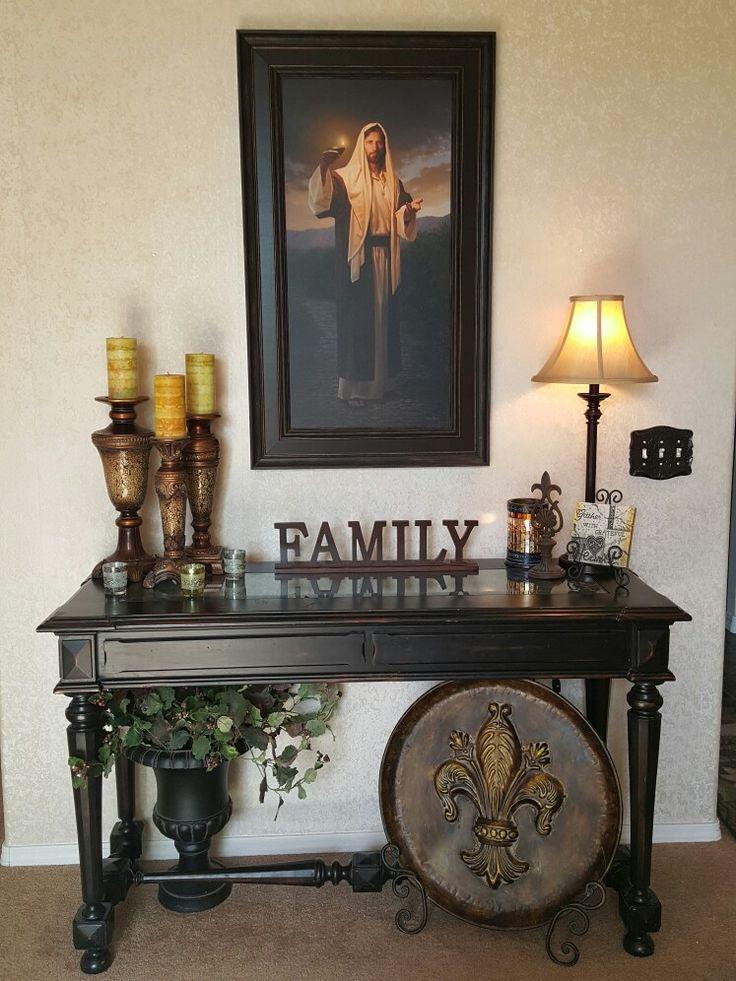 Elegant Foyer Table Decor : Jesus portrait above an elegant entry table