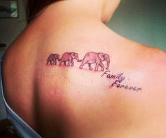 I've always loved this idea!! > Three Elephant Tattoos on upper back. I kind of love the idea of one being for mom one for dad and then keep adding on for each child.