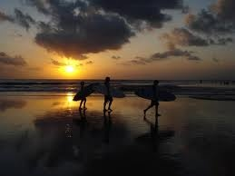surfers at Legian Beach, Bali