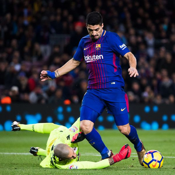 Ruben Martinez of Deportivo La Coruna clears a ball conducted by Luis Suarez of FC Barcelona during the La Liga match between FC Barcelona and Deportivo La Coruna at Camp Nou on December 17, 2017 in Barcelona.