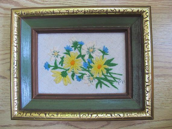 Pretty yellow and blue flower bouquet framed crewel picture. Overall size is 10 by 8 inches. Signed PH in black thread. Very good condition. Nicely finished and framed.  **Canadian shoppers - the shipping price has been estimated.** shipping will be between about $8 and $16 USD