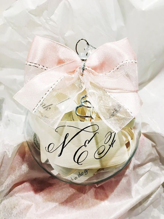 Garter Girl Loves: This personalized wedding invitation ornament with bow and charm. #garter #weddinggarter #bridalgarter #gartergirl #tooprettytotoss #weddingheirloom #modernheirloom #thegartergirl #wedding #bridalstyle #bride #bridalfashion #bridegift #giftforbride #weddingmorning #weddingday #gartertoss #weddingtradition #GarterGirlLoves