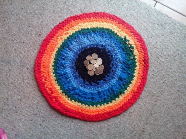 A rainbow rug which measures 48 centimetres across.