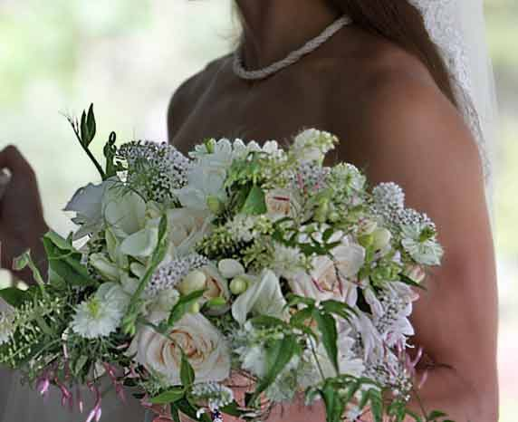 Just gorgeous, lightly cascading blush, and white, Maine summer wildflower, Bridal Botanical Bouquet composed of jasmine, sweetpepper bush, sweeetpeas, loosestrife, calla lilies, white love in a mist, roses, tuberoses and prairie gentian.