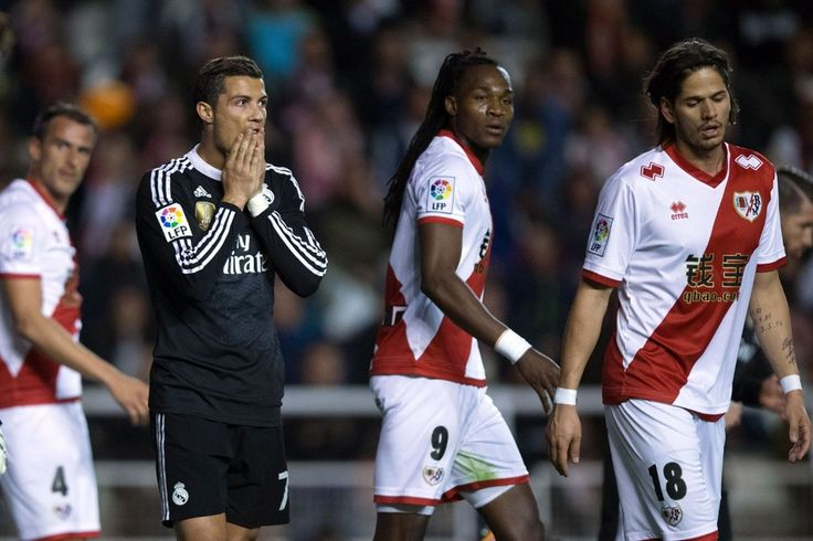 Christiano Ronaldo looks in awe by the @RayoVallecano players around him #9ine
