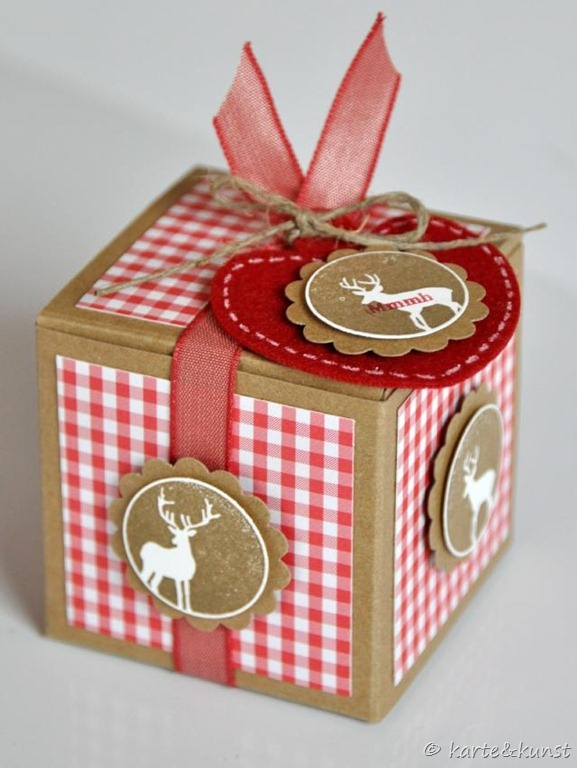 Verpakking waarbij de ronde schulpmal is gebruikt om het doosje te versieren.