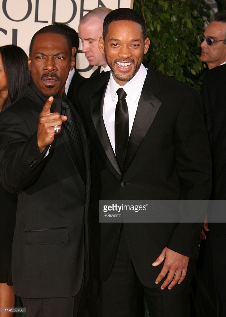 Eddie Murphy and Will Smith during 64th Annual Golden Globe Awards - Arrivals at…