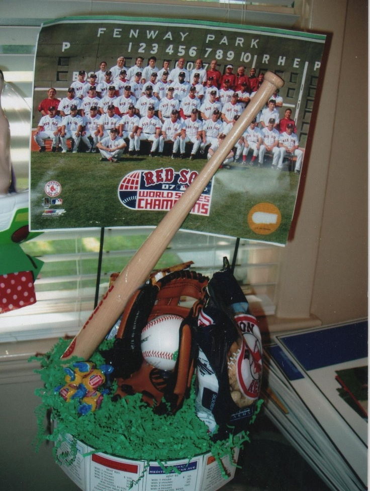 The head table had centerpieces that were of Baseball  since Baseball  was a big part of the  Bar Mitzvah boy's life  For unusual centerpieces call What A Party 508 572 4154