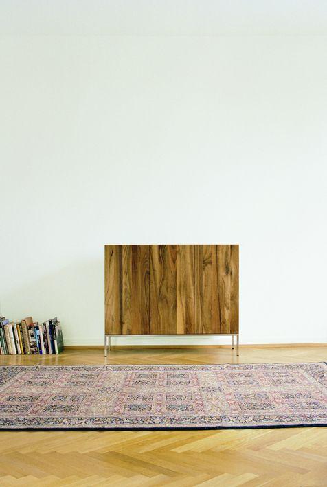 Solid walnut sideboard FARIBA by Philipp Mainzer with three vertical doors. / www.e15.com #e15 #persian #carpet