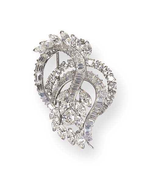A DIAMOND BROOCH, BY HARRY WINSTON   Designed as baguette and circular-cut diamond scrolling ribbons, enhanced by pear-shaped and marquise-cut diamonds, mounted in platinum  Signed Winston for Harry Winston